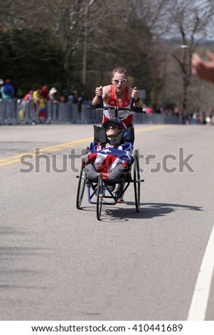BOSTON - APRIL 18: Team Hoyt  runs in their 33rd marathon up Heartbreak Hill during the Boston Marathon April 18, 2016 in Boston. [public race]