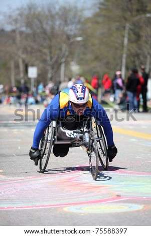 BOSTON - APRIL 18 : Wheelchair and Handcycle Racers participated in the Boston Marathon on April 18, 2011 in Boston. - stock photo