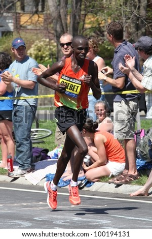 BOSTON - APRIL 16: Wilson Chebet races up Heartbreak Hill during the Boston Marathon on a hot 87 degree day on April 16, 2012 in Boston. Korir, Wesley (Kenya) finished first with a time of 2:12:40. - stock photo