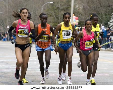 BOSTON- APRIL 20: Women runners races up the Heartbreak Hill during the Boston Marathon April 20, 2009 in Boston. Salina Kosgei (Kenya) won the women's category with 2:32:16. - stock photo