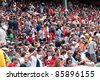 Boston - August 8: New York Yankees and Boston Red Sox fans in the stands on August 8, 2011 at Fenway Park in Boston, Massachusetts. - stock photo
