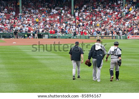 Boston - August 8: New York Yankees starting pitcher, #52, C.C. Sabathia and catcher, #17, Francisco Cervelli make their way to the mound on August 8, 2011 at Fenway Park in Boston, Massachusetts. - stock photo