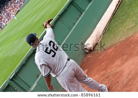 Boston - August 8: New York Yankees starting pitcher, #52, C.C. Sabathia warms up in the visiting bullpen before the game on August 8, 2011 at Fenway Park in Boston, Massachusetts. - stock photo