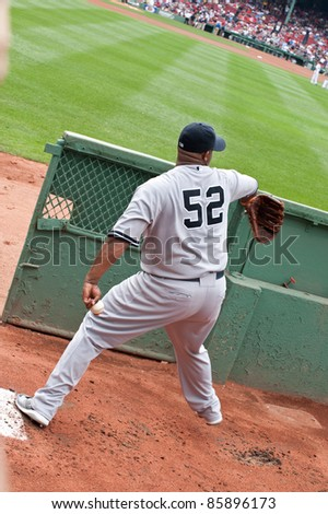 Boston - August 8: New York Yankees starting pitcher, #52, C.C. Sabathia warms up in the visiting bullpen before the game on August 8, 2011 at Fenway Park in Boston, Massachusetts.