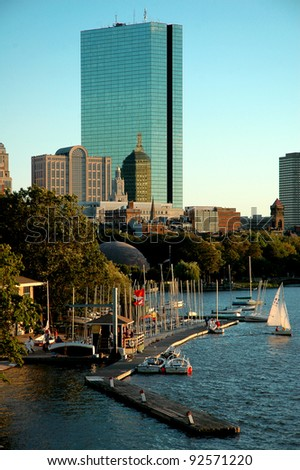 Boston back bay with sailing boat and urban building, Boston, Massachusetts - stock photo