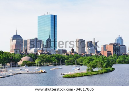 Boston back bay with sailing boat and urban building city skyline in the morning. - stock photo