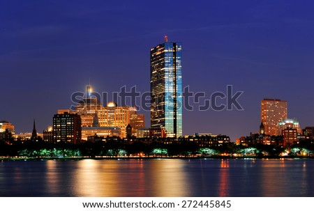 Boston Charles River at dusk with urban city skyline and light reflection - stock photo