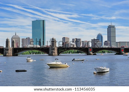 Boston Charles River cityscape with urban city skyline skyscrapers and boats with blue sky.