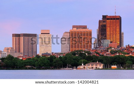Boston Charles River sunset with urban skyline and skyscrapers