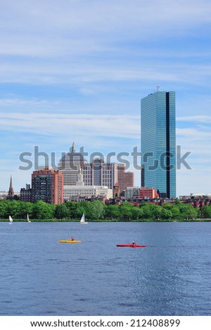 Boston Charles River with urban city skyline Hancock building and boat. - stock photo