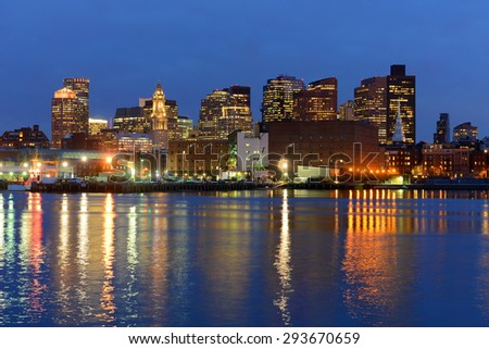 Boston City Skyscrapers, Custom House and Boston Waterfront at night from East Boston, Boston, Massachusetts, USA - stock photo