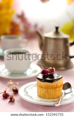 Boston Cream Pie cupcake filled with pastry cream, topped with chocolate glaze - stock photo