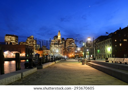 Boston Custom House, Long Wharf and Financial District skyline at night, Boston, Massachusetts, USA - stock photo