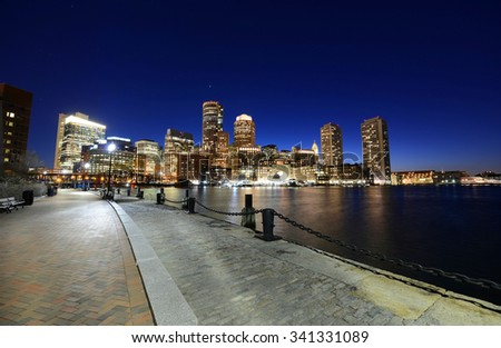 Boston Custom House, Rowes Wharf and Financial District skyline at night, Boston, Massachusetts, USA - stock photo