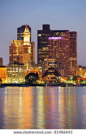 Boston downtown at dusk with urban buildings illuminated at dusk after sunset. - stock photo