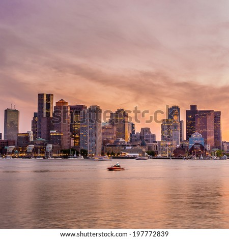 Boston downtown skyline panorama with skyscrapers over water at twilight