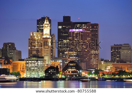 Boston downtown urban skyscrapers over water at dusk. - stock photo