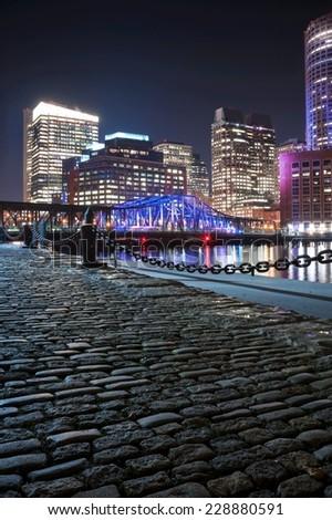 Boston Harbor and Financial District at night in Boston, Massachusetts. - stock photo
