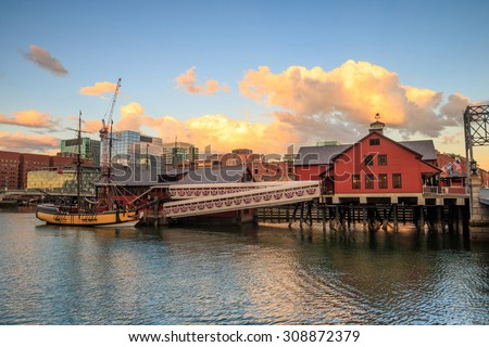 Boston Harbor and Financial District at sunset and Tea Party Ships & Museum in Boston, Massachusetts. - stock photo