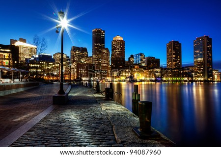 Boston Harbor and Financial District in Boston, Massachusetts at Sunset. - stock photo