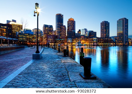 Boston Harbor and Financial District in Boston, Massachusetts in the sunset. - stock photo