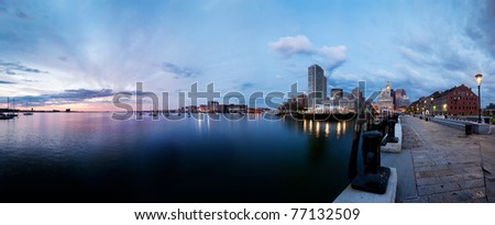 Boston harbor, Rowe's Wharf and the waterfront at sunrise - stock photo
