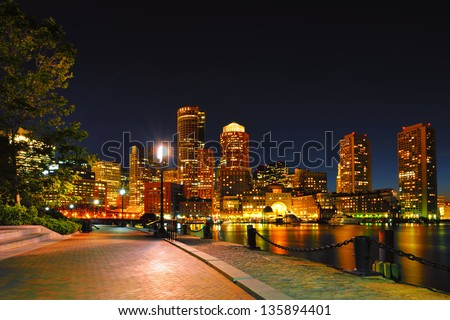 Boston Harborwalk and Cityscape at Night - stock photo