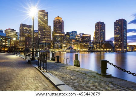 Boston in Massachusetts, USA at sunset showcasing its mix of modern and historic building at Boston Harbor in the Financial District.