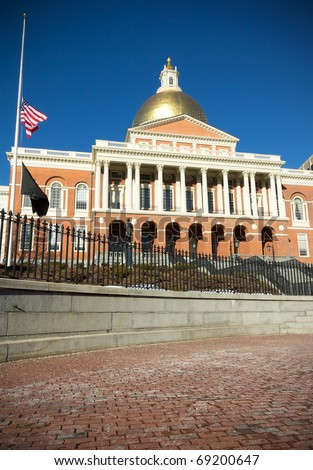 BOSTON - JANUARY 10: One of the most famous landmarks of Boston, the Massachusetts State House, gets visited by hundreds of tourists every year despite the cold weather on January 10th, 2011 in Boston. - stock photo