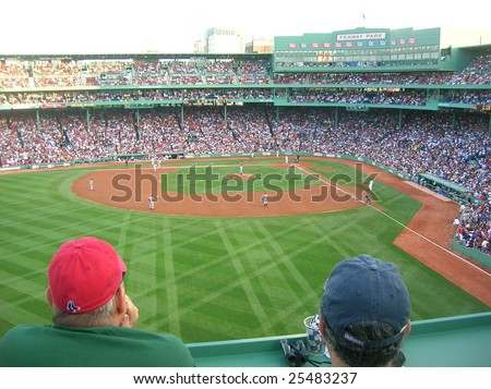 Boston - July 2008: Watching a Red Sox game at historic Fenway Park from Green Monster in left field in July 2008. - stock photo