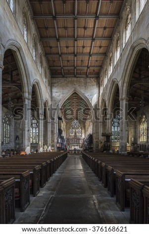BOSTON, LINCOLNSHIRE, ENGLAND - AUGUST 27, 2015:  ST. BOTOLPH'S CHURCH INTERIOR VIEWED DOWN CENTRAL AISLE TOWARDS THE HIGH ALTER