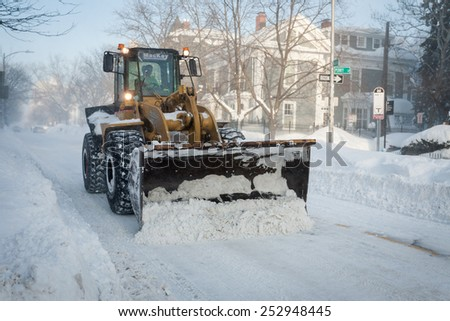 BOSTON, MA - FEBRUARY 15, 2015: The fourth major winter storm in as many weeks brings heavy snowfall and blizzard conditions, road crews work endlessly to clear snow-congested roads