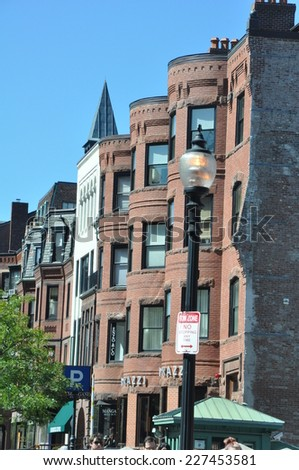 BOSTON, MA - SEP 14: Newbury Street in Boston, as seen on Sep 14, 2014. It is a mile long street lined with historic 19th-century brownstones that contain hundreds of upscale shops and restaurants. - stock photo