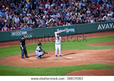 BOSTON, MA - SEPT. 28: Kevin Youkilis at bat during against the Toronto Blue Jays at Fenway Park in Boston, Massachusetts on Sept. 28, 2009. - stock photo