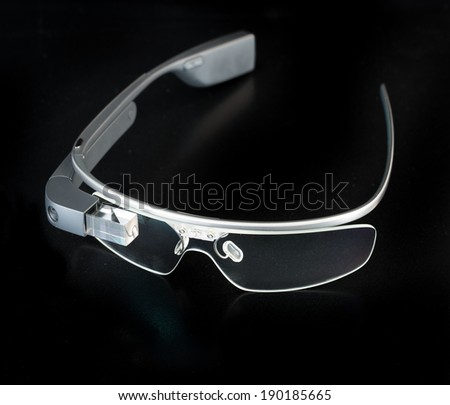 BOSTON, MA, USA - MAY 1, 2014: A photo of Google Glass. Google Glass is a wearable computer with an optical head-mounted display that is being developed by Google - stock photo