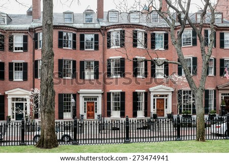 BOSTON, MASSACHUSETTS APRIL 26th: Louisburg Square is a private square located in the Beacon Hill neighborhood of Boston.  One of the most expensive areas of Boston in MA on April 26th, 2015. - stock photo