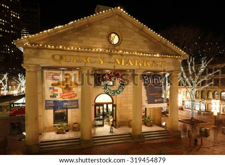Boston, Massachusetts - December 2014: Quincy Market at Night during Christmas time. Quincy Market is a historic market complex near Faneuil Hall in downtown Boston, Massachusetts.
