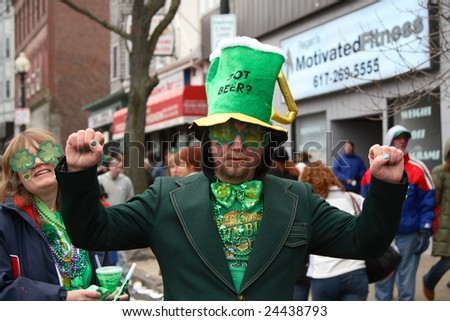 BOSTON, MASSACHUSETTS - MARCH 16: An unidentified man wearing a green suit and showing the spirit of the Saint Patrick's parade. The event was held in Boston, Massachusetts on March 16, 2008. - stock photo