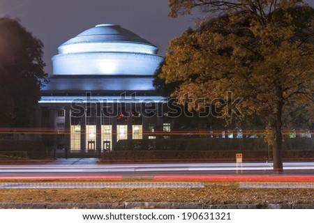 BOSTON, MASSACHUSETTS-OCTOBER 31: MIT Massachusetts Institute of Technology at night with traffic light trails on October 31, 2013. in Boston Massachusetts, USA - stock photo