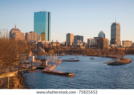 Boston, Massachusetts, USA Back Bay neighborhood. The tallest building is the John Hancock Tower and the Charles River is in the for-ground.