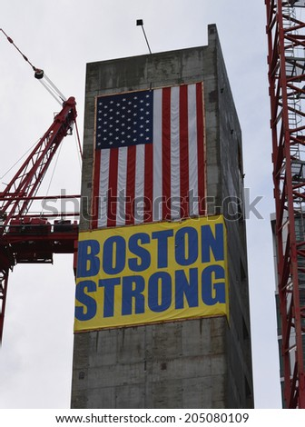 """Boston Massachusetts, USA - July 5, 2014: """"Boston Strong"""" banner hung to honor those affected by the marathon bombings on a construction site in Boston.  - stock photo"""