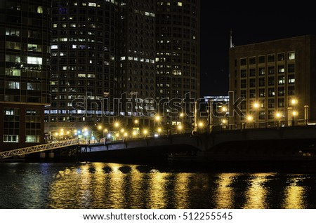 Boston, Massachusetts, USA - October 20, 2016: Pre-dawn view across Fort Point Channel toward Seaport Blvd and Boston financial district