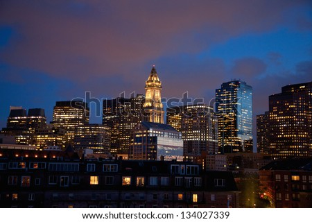 BOSTON - MAY 24: Boston skyline and Custom House Tower at dusk on May 24, 2012 in Boston, MA