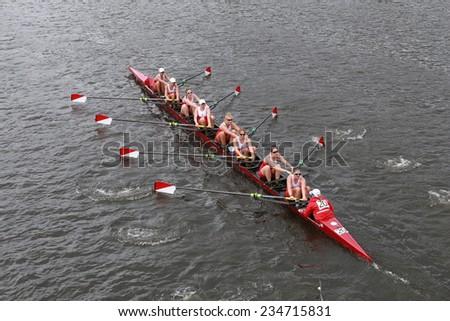BOSTON - OCTOBER 19, 2014: Boston University races in the Head of Charles Regatta Women's Championship Eights - stock photo