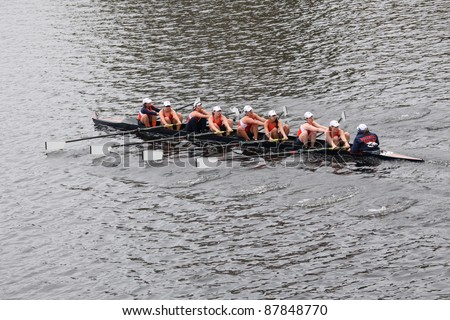 BOSTON - OCTOBER 23: Bucknell University women's Eights races in the Head of Charles Regatta. Williams College won with a time of 14:17 on October 23, 2011 in Boston, MA. - stock photo