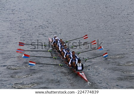 BOSTON - OCTOBER 19, 2014: Cambridge Boat Club races in the Head of Charles Regatta Men's Championship Eights, Craftsbury Sculling Center won with a time of 14:20 - stock photo