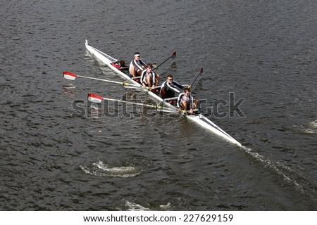 BOSTON - OCTOBER 19, 2014: FIT Rowing races in the Head of Charles Regatta Men's Championship Fours - stock photo