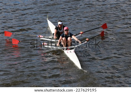 BOSTON - OCTOBER 19, 2014:Lisa Schlenker Kelly Salchow MacArthur  races in the Head of Charles Regatta women's Doubles - stock photo