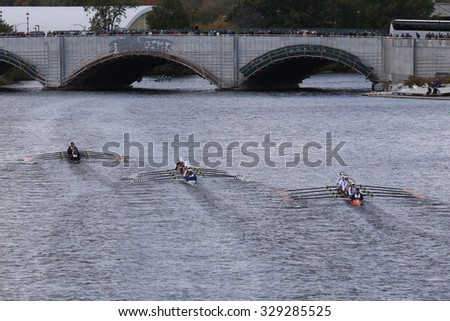 BOSTON - OCTOBER 18, 2015: Marin(left), Saratoga(center),OKC Riversport(right) races in the Head of Charles Regatta Women's Youth Eights - stock photo