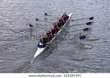 BOSTON - OCTOBER 18, 2015:  Marina Aquatic Center races in the Head of Charles Regatta Women's Youth Eights - stock photo